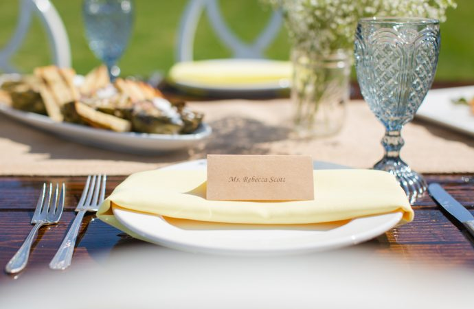 Name card on decorated table setting outdoors