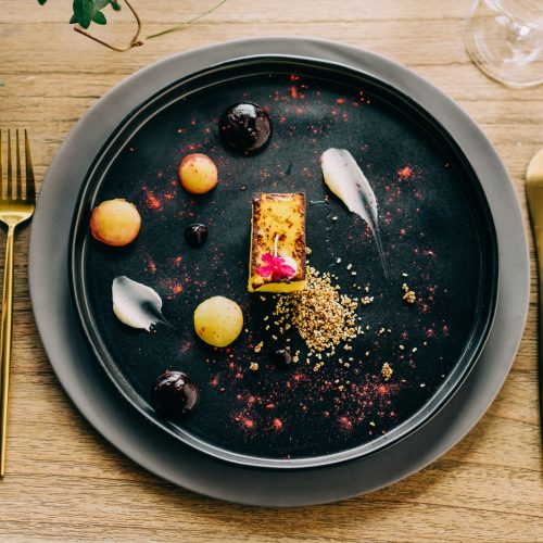 modern, contemporary food arrangement on dark plate